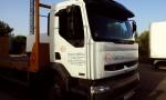Camión góndola para transportar maquinaria